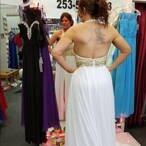 White with gold embellishments. Halter style